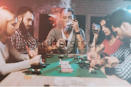 young-friends-playing-poker-on-450w-1249117876.jpg